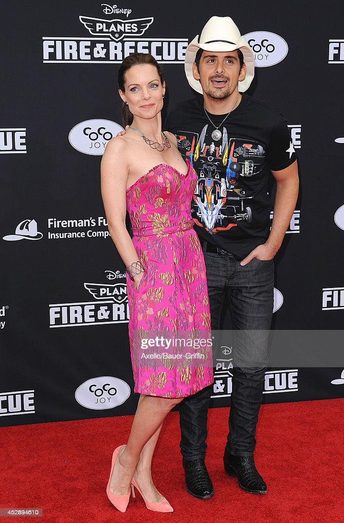 Actress <a gi-track='captionPersonalityLinkClicked' href=/galleries/search?phrase=Kimberly+Williams-Paisley&family=editorial&specificpeople=208903 ng-click='$event.stopPropagation()'>Kimberly Williams-Paisley</a> (L) and husband singer <a gi-track='captionPersonalityLinkClicked' href=/galleries/search?phrase=Brad+Paisley&family=editorial&specificpeople=206616 ng-click='$event.stopPropagation()'>Brad Paisley</a> attend the premiere of 'Planes: Fire & Rescue' at the El Capitan Theatre on July 15, 2014 in Hollywood, California.