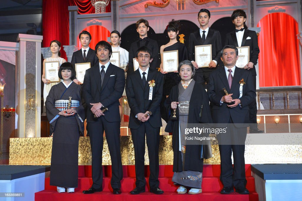 Actress Kimiko Yo, Actor Hiroshi Abe, Director Daihachi Yoshida, Actress Kirin Kiki and Tetsuya Yamamoto, representative of actor Hideji Otaki, (back row, L to R) Actress Yuko Oshima, Actor Shota Sometani, Actress Emi Takei, Actor and Singer Changmin, Actress Ai Hashimoto, Actor Masahiro Higashide and Actor Tori Matsuzaka pose on the podium during the 36th Japan Academy Prize Award Ceremony at Grand Prince Hotel Shin Takanawa on March 8, 2013 in Tokyo, Japan.