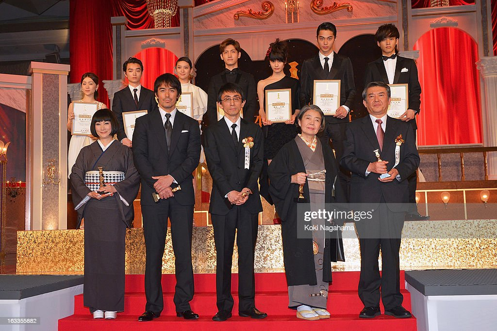 Actress Kimiko Yo, Actor Hiroshi Abe, Director Daihachi Yoshida, Actress Kirin Kiki and Tetsuya Yamamoto, representative of actor Hideji Otaki, (back row L to R) Actress Yuko Oshima, Actor Shota Sometani, Actress Emi Takei, Actor and Singer Changmin, Actress Ai Hashimoto, Actor Masahiro Higashide and Actor Tori Matsuzaka pose on the podium during the 36th Japan Academy Prize Award Ceremony at Grand Prince Hotel Shin Takanawa on March 8, 2013 in Tokyo, Japan.