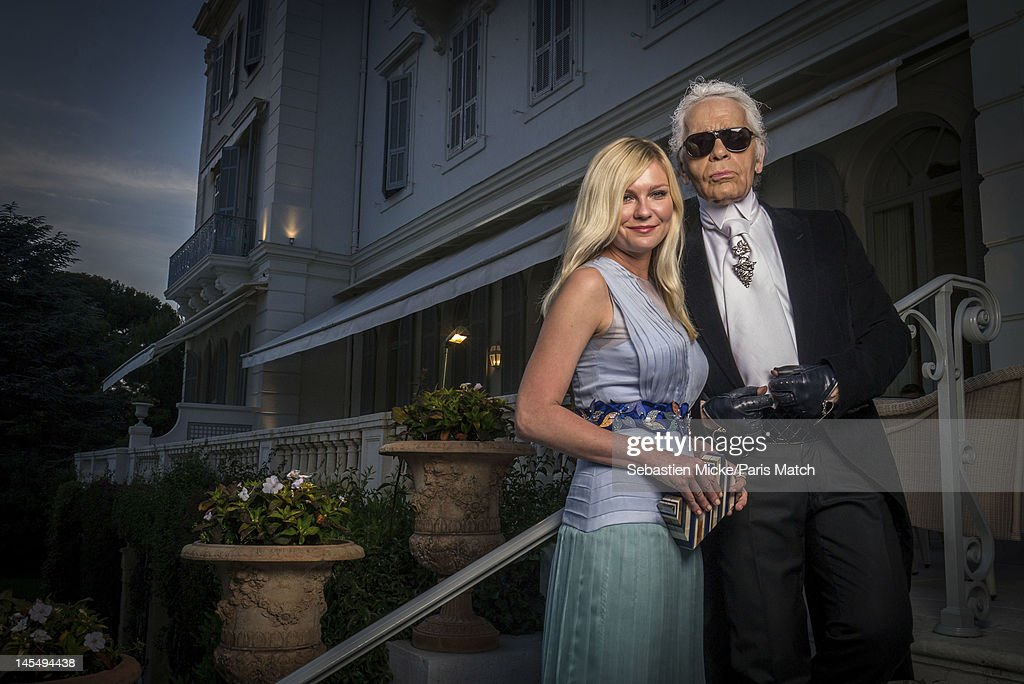 Actress Kirsten Dunst and Karl Lagerfeld, photographed at the amfAR Cinema Against AIDS gala, for Paris Match on May 24, 2012, in Cap d'Antibes, France.