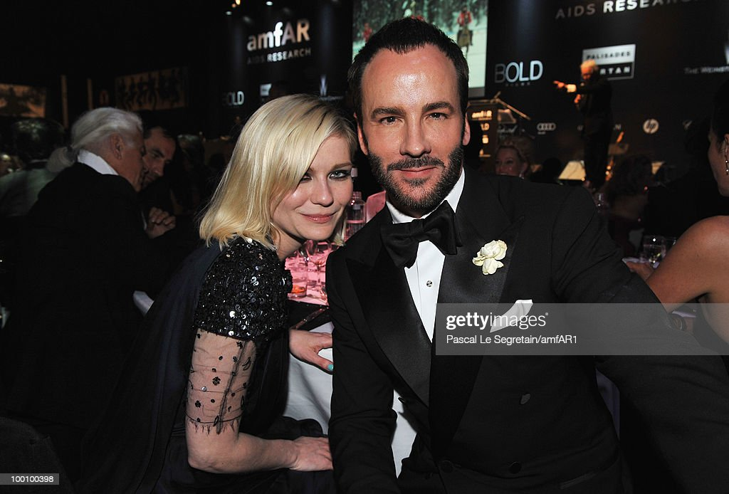 Actress Kirsten Dunst (L) and Tom Ford attend amfAR's Cinema Against AIDS 2010 benefit gala dinner at the Hotel du Cap on May 20, 2010 in Antibes, France.