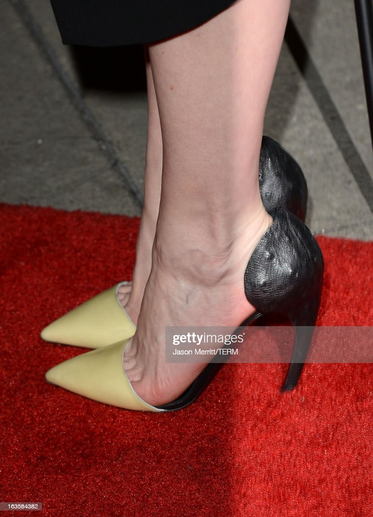 Actress Kirsten Dunst (shoe detail) arrives at a special LA screening of Millennium Entertainment's 'Upside Down' at ArcLight Hollywood on March 12, 2013 in Hollywood, California.