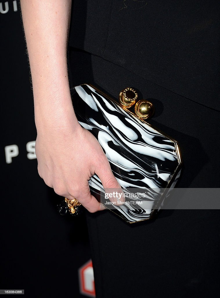 Actress Kirsten Dunst (handbag detail) arrives at a special LA screening of Millennium Entertainment's 'Upside Down' at ArcLight Hollywood on March 12, 2013 in Hollywood, California.