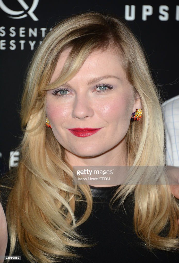 Actress <a gi-track='captionPersonalityLinkClicked' href=/galleries/search?phrase=Kirsten+Dunst&family=editorial&specificpeople=171590 ng-click='$event.stopPropagation()'>Kirsten Dunst</a> arrives at a special LA screening of Millennium Entertainment's 'Upside Down' at ArcLight Hollywood on March 12, 2013 in Hollywood, California.