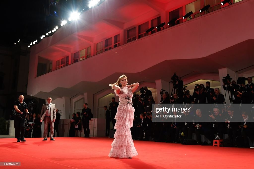 TOPSHOT - Actress Kirsten Dunst attends the premiere of the movie 'Woodshock' presented in the 'Cinema nel Giardino' selection at the 74th Venice Film Festival on September 4, 2017 at Venice Lido. /