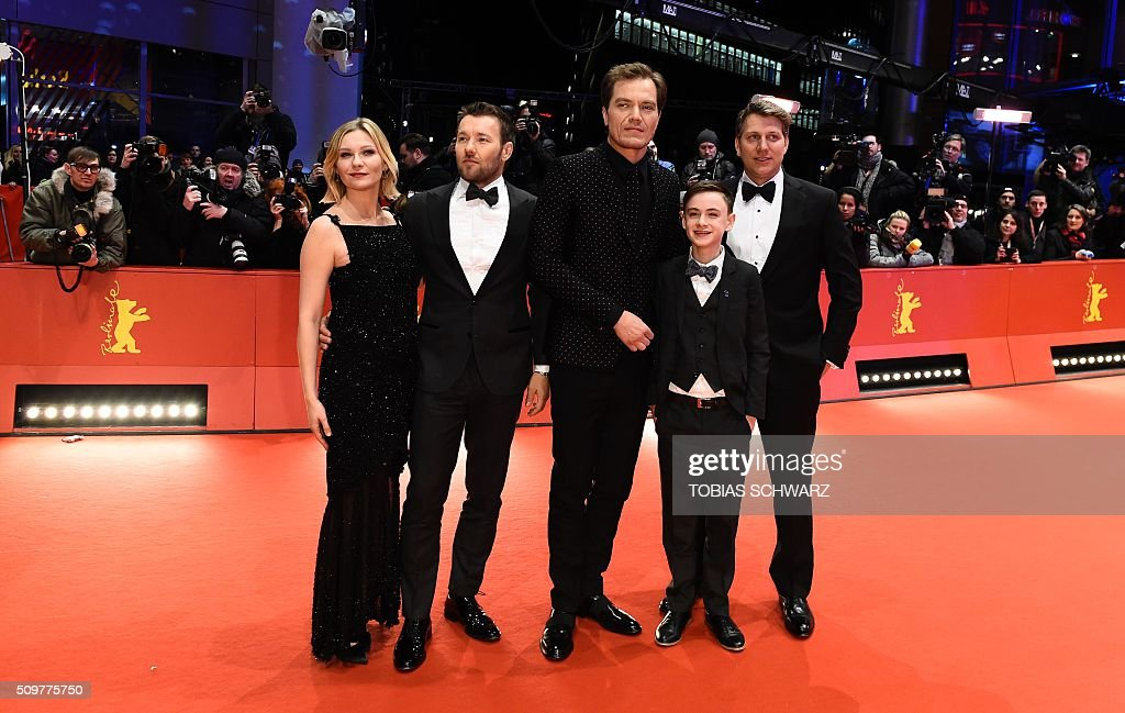 US actress Kirsten Dunst, Australian actor Joel Edgerton, US actor Michael Shannon US actor Jaeden Lieberher and US director Jeff Nichols pose for photographers as she arrives for the screening of the film ' Midnight Special by Jeff Nichols' in competition of the 66th Berlinale Film Festival in Berlin on February 12, 2016. / AFP / TOBIAS SCHWARZ