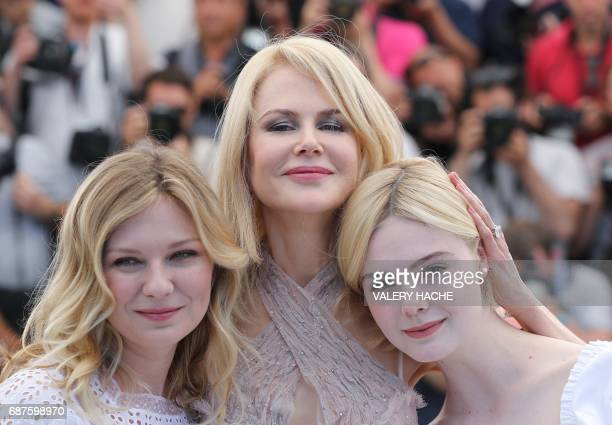 US actress Kirsten Dunst Australian actress Nicole Kidman and US actress Elle Fanning pose on May 24 2017 during a photocall for the film 'The...