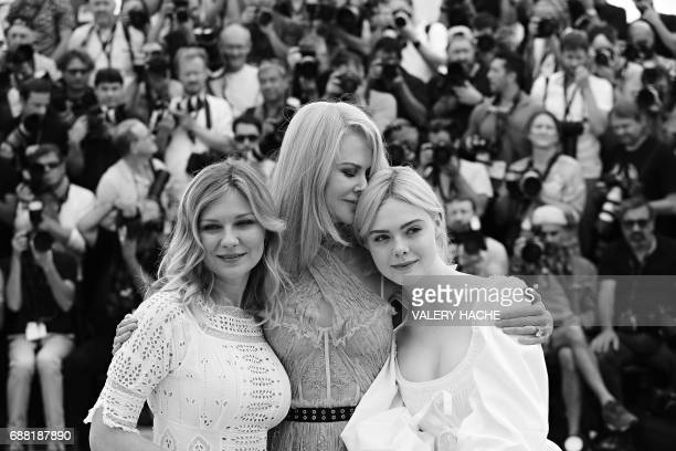 US actress Kirsten Dunst AustralianUS actress Nicole Kidman and US actress Elle Fanning pose on May 24 2017 during a photocall for the film 'The...