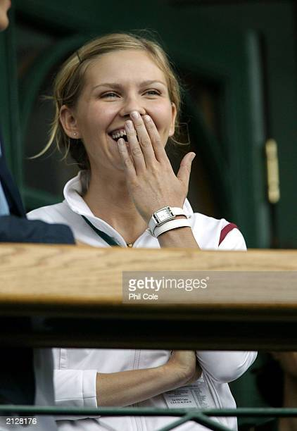 Actress Kirsten Dunst laughs during the filming of the movie 'Wimbledon' during the women's quarter finals day of the Wimbledon Tennis Championships...