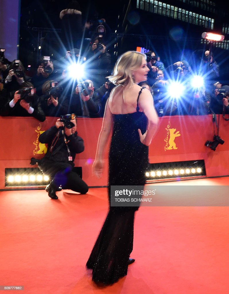 US actress Kirsten Dunst poses for photographers as she arrives for the screening of the film ' Midnight Special by Jeff Nichols' in competition of the 66th Berlinale Film Festival in Berlin on February 12, 2016. / AFP / TOBIAS SCHWARZ