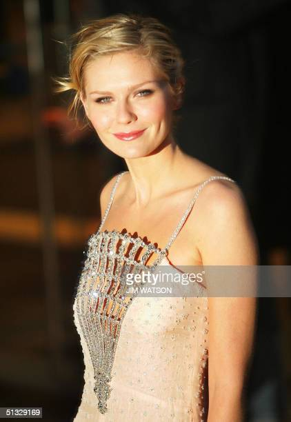 US actress Kirsten Dunst poses for photographers as she arrives for the premiere of 'Wimbledon' in which she plays a tennis ace at the Odeon Theatre...