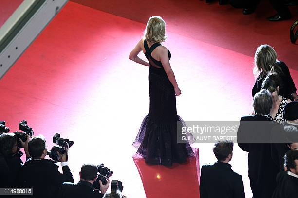 US actress Kirsten Dunst poses on the red carpet before the screening of 'Melancholia' presented in competition at the 64th Cannes Film Festival on...