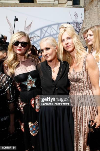 Actress Kirsten Dunst Stylist Maria Grazia Chiuri and Sandrine Kiberlain pose backstage after the Christian Dior Haute Couture Fall/Winter 20172018...