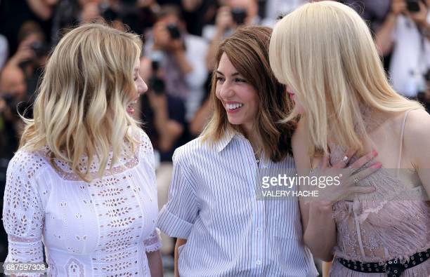 US actress Kirsten Dunst US director Sofia Coppola and Australian actress Nicole Kidman laugh on May 24 2017 during a photocall for the film 'The...