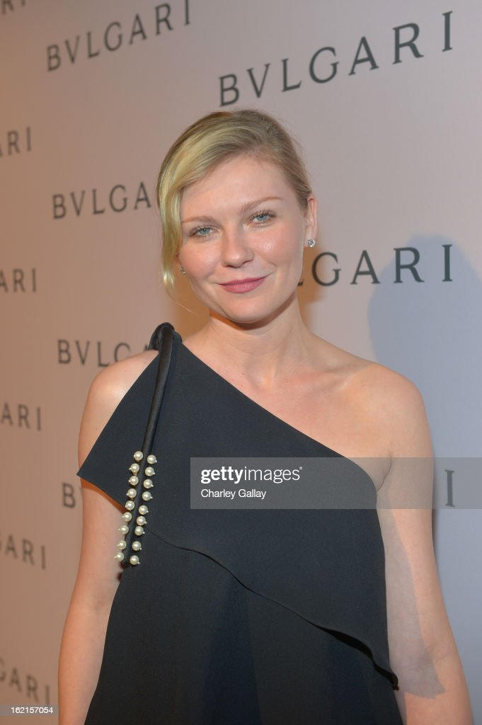 Actress Kirsten Dunst, wearing BVLGARI, arrives at the BVLGARI celebration of Elizabeth Taylor's collection of BVLGARI jewelry at BVLGARI Beverly Hills on February 19, 2013 in Los Angeles, California.