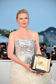 Actress Kirsten Dunst with her Award for Best Actress in the film 'Melancholia' at the photo call for 'Palme D'Or Winners' during the 64th Cannes...