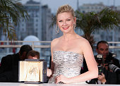 Actress Kirsten Dunst with her Award for Best Actress in the film 'Melancholia' during the Palme D'Or Winners Photocall at the 64th Annual Cannes...
