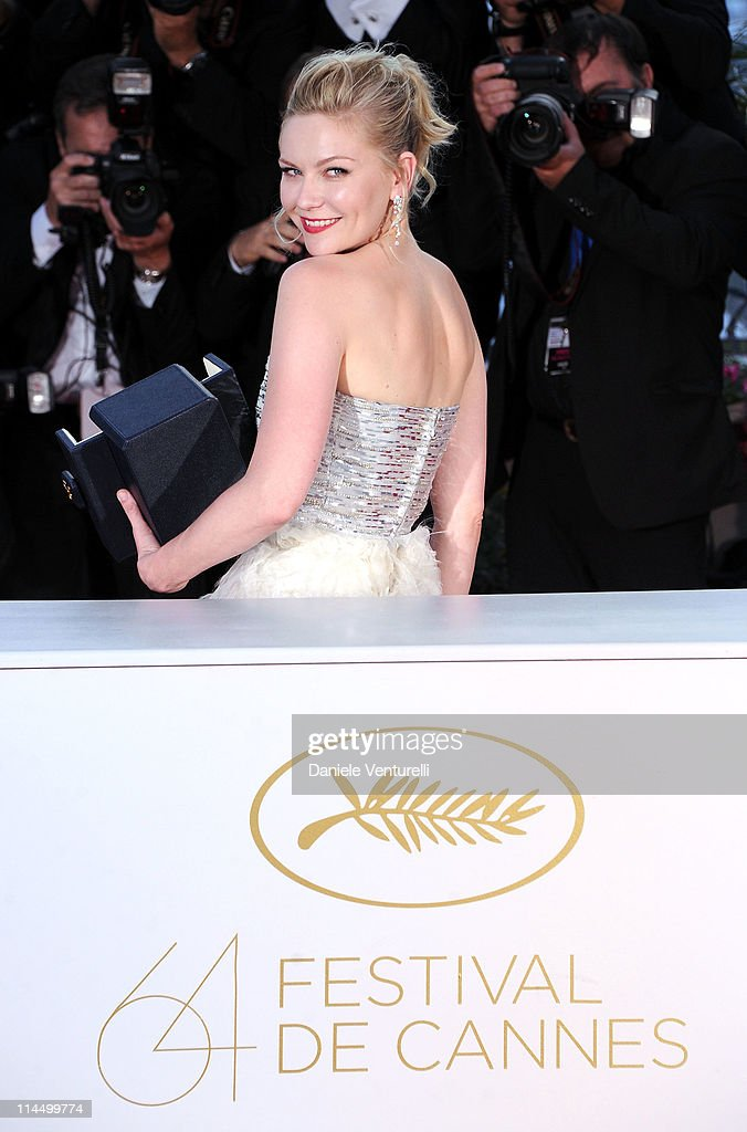 Actress Kirsten Dunst with her Award for Best Actress in the film 'Melancholia' during the Palme D'Or Winners Photocall at the 64th Annual Cannes Film Festival at the Palais des Festivals on May 22, 2011 in Cannes, France.