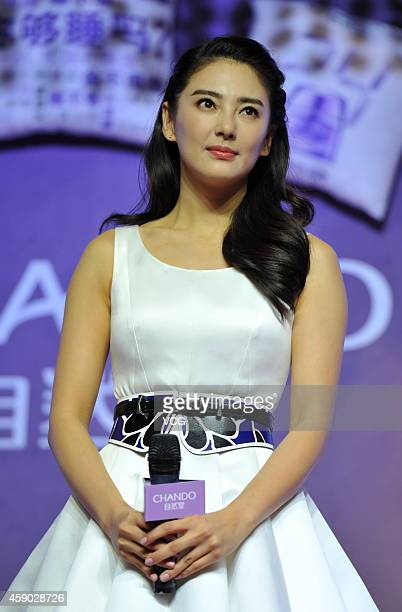 Actress Kitty Zhang attends commercial activity of Chando on November 14 2014 in Beijing China Her husband Wang Quan'an was detained recently on...