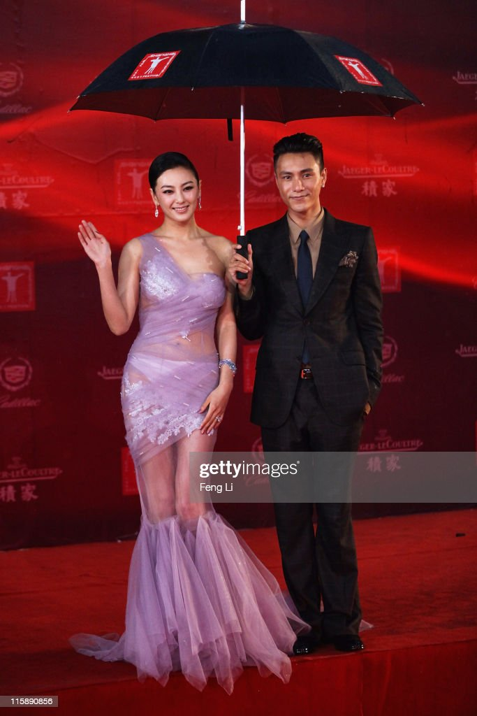 Actress Kitty Zhang Yuqi and actor Chen Kun arrive at the opening ceremony of the 14th Shanghai International Film Festival on June 11, 2011 in Shanghai, China.