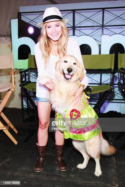 Actress Kristen Bell poses with Dancing Merengue Dog during Day 2 of Bonaroo 2012 on June 8 2012 in Manchester Tennessee