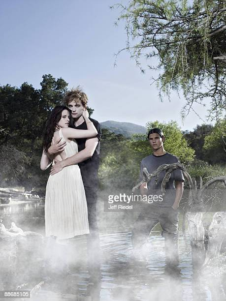 Actress Kristen Stewart actor Robert Pattinson and actor Taylor Lautner pose as their characters from the Twilight movies at a portrait session for...