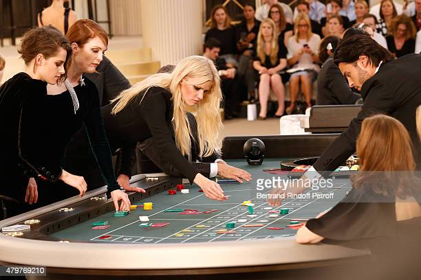 Actress Kristen Stewart Actress Julianne Moore Model Lara Stone Baptiste Giabiconi and Actress Isabelle Huppert attend the Chanel show as part of...