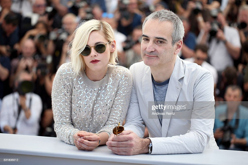 Actress Kristen Stewart and Director Olivier Assayas attend the 'Personal Shopper' photocall during the 69th annual Cannes Film Festival at the Palais des Festivals on May 17, 2016 in Cannes, France.