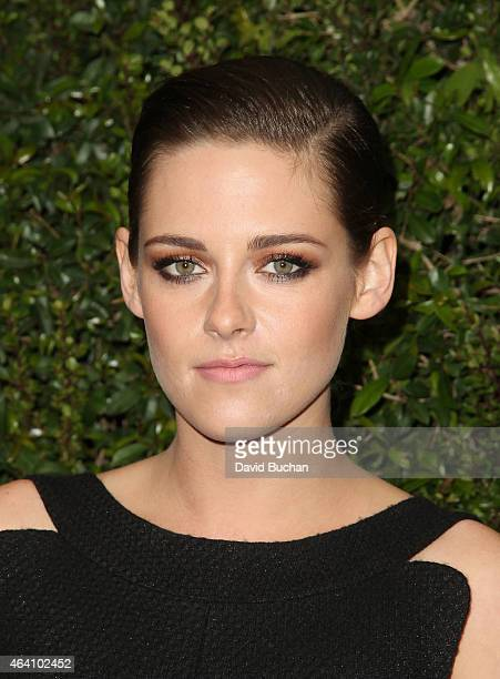 Actress Kristen Stewart attends the Chanel and Charles Finch PreOscar Dinner at Madeo Restaurant on February 21 2015 in Los Angeles California
