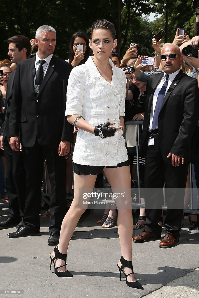 Actress Kristen Stewart attends the Chanel show as part of Paris Fashion Week Haute-Couture Fall/Winter 2013-2014 at Grand Palais on July 2, 2013 in Paris, France.