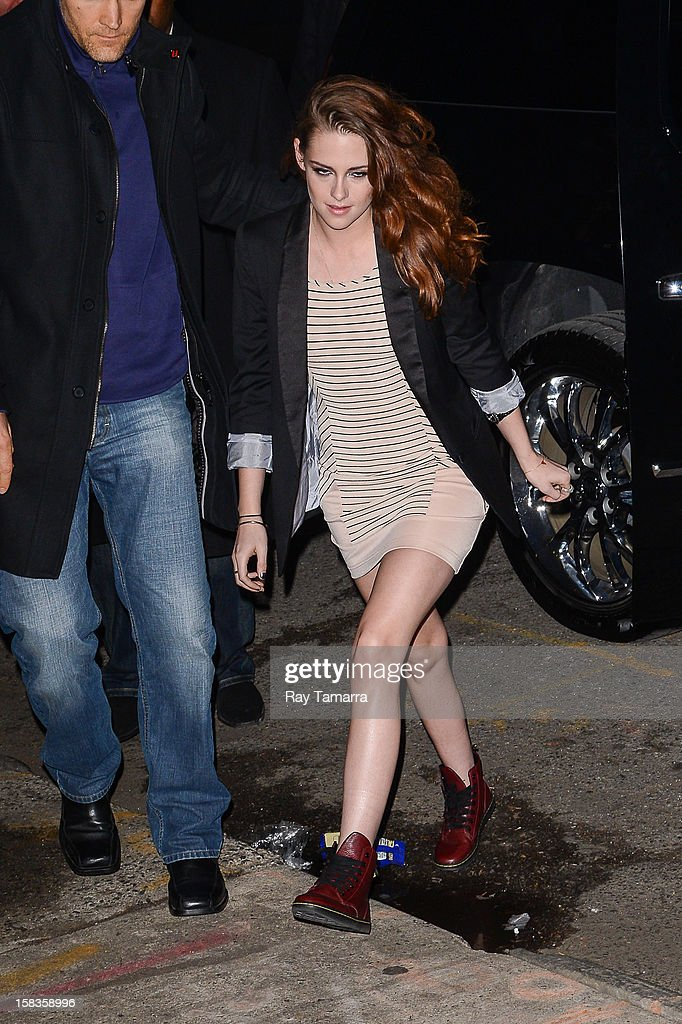 Actress Kristen Stewart enters the 'Daily Show With Jon Stewart' at the NEP Studio 52 on December 13, 2012 in New York City.