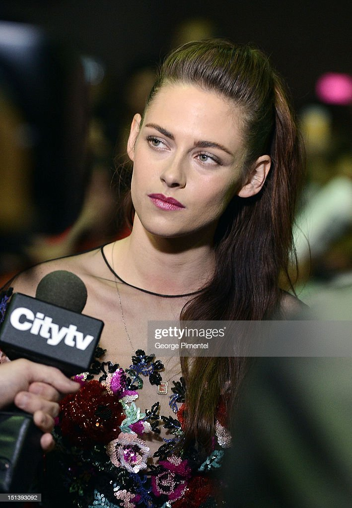 Actress <a gi-track='captionPersonalityLinkClicked' href=/galleries/search?phrase=Kristen+Stewart&family=editorial&specificpeople=2166264 ng-click='$event.stopPropagation()'>Kristen Stewart</a> is interviewed as she attends the 'On The Road' premiere during the 2012 Toronto International Film Festivalon September 6, 2012 in Toronto, Canada.