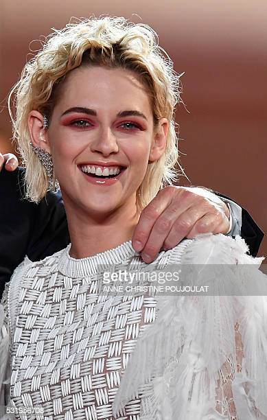 US actress Kristen Stewart pose as she arrives on May 17 2016 for the screening of the film 'Personal Shopper' at the 69th Cannes Film Festival in...