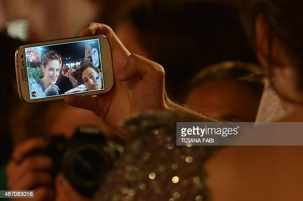 US actress Kristen Stewart poses with fans as she arrives for the screening of the movie 'Equals' presented in competition at the 72nd Venice...