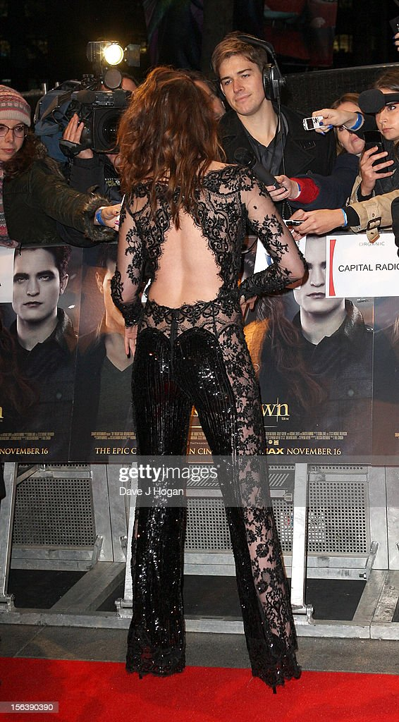 Actress Kristen Stewart signs autographs for fans as she attends the UK Premiere of 'The Twilight Saga: Breaking Dawn - Part 2' at Odeon Leicester Square on November 14, 2012 in London, England.