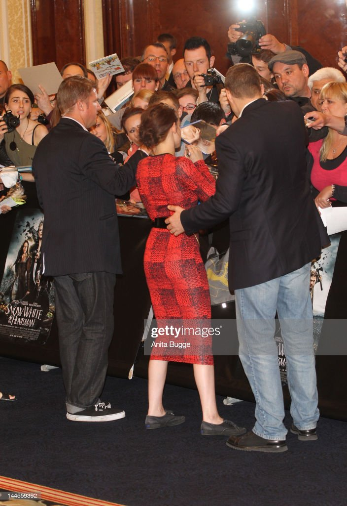 Actress Kristen Stewart signs autographs for fans at the 'Snow White And The Huntsman' photocall at Ritz Carlton Hotel on May 16, 2012 in Berlin, Germany.