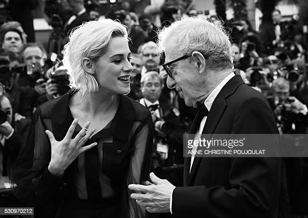 US actress Kristen Stewart talks with US director Woody Allen as they arrive on May 11 2016 for the screening of the film 'Cafe Society' during the...