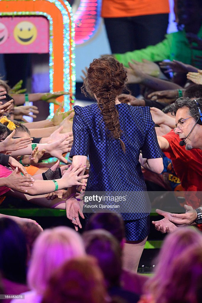 Actress Kristen Stewart walks onstage to accept the Favorite Movie Actress Award for 'The Twilight Saga: Breaking Dawn – Part 2,' during Nickelodeon's 26th Annual Kids' Choice Awards at USC Galen Center on March 23, 2013 in Los Angeles, California.