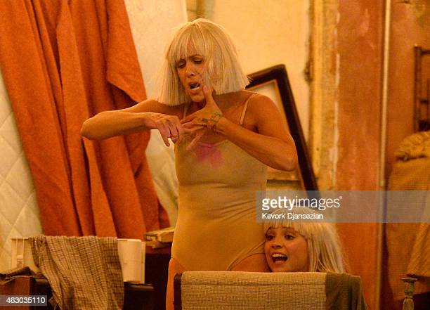Actress Kristen Wiig and dancer Maddie Ziegler lipsync Sia's 'Chandeleir' onstage during The 57th Annual GRAMMY Awards at the at the STAPLES Center...