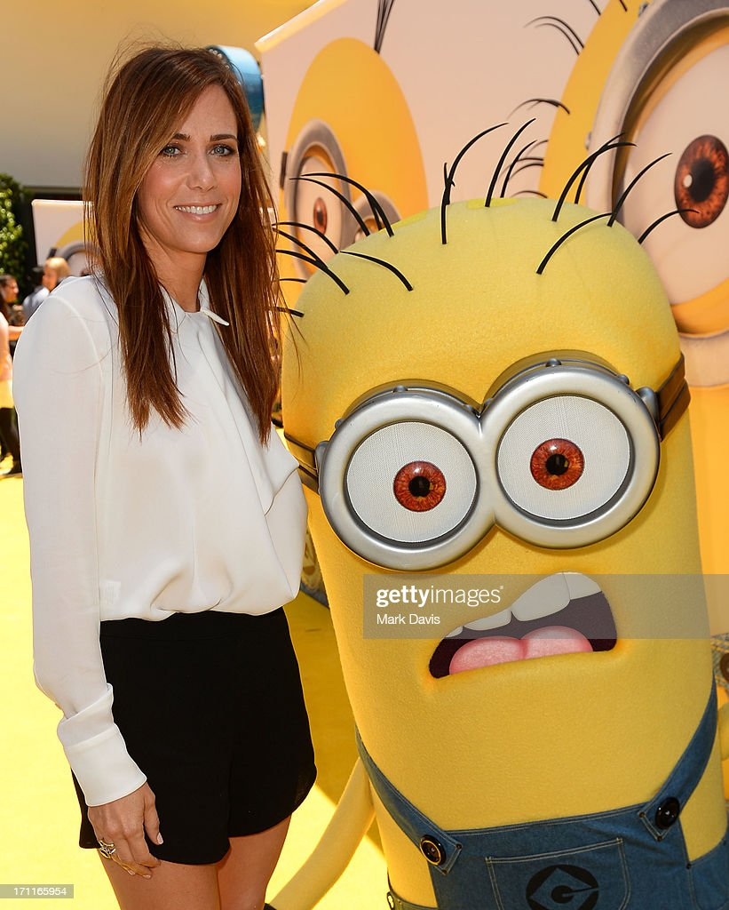 Actress <a gi-track='captionPersonalityLinkClicked' href=/galleries/search?phrase=Kristen+Wiig&family=editorial&specificpeople=4029391 ng-click='$event.stopPropagation()'>Kristen Wiig</a> (L) arrives at the premiere of Universal Pictures' 'Despicable Me 2' at Gibson Amphitheatre on June 22, 2013 in Universal City, California.