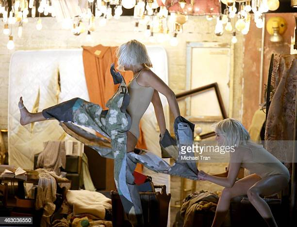 Actress Kristen Wiig dancer Maddie Ziegler and recording artist Sia perform onstage during The 57th Annual GRAMMY Awards at STAPLES Center on...