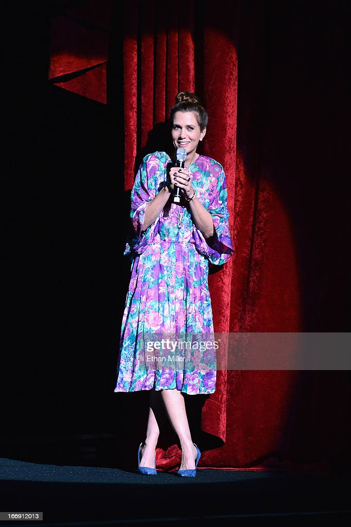Actress Kristen Wiig speaks during a Twentieth Century Fox presentation to promote the upcoming film 'The Secret Life of Walter Mitty' at Caesars Palace during CinemaCon, the official convention of the National Association of Theatre Owners, on April 18, 2013 in Las Vegas, Nevada.