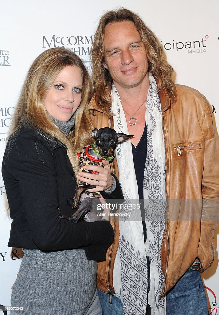 Actress <a gi-track='captionPersonalityLinkClicked' href=/galleries/search?phrase=Kristin+Bauer&family=editorial&specificpeople=3164038 ng-click='$event.stopPropagation()'>Kristin Bauer</a> van Straten (L) and husband musician Abri Van Straten attend the Amanda Foundation's annual 'Bow Wow Beverly Hills' Halloween Event at Two Rodeo on October 27, 2013 in Beverly Hills, California.