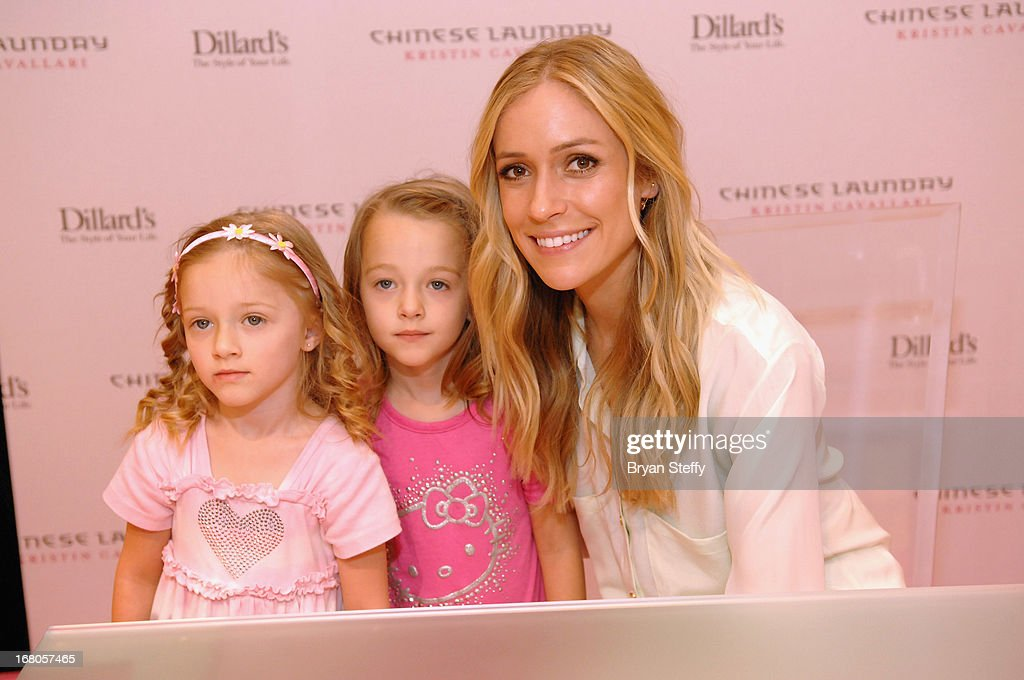 Actress <a gi-track='captionPersonalityLinkClicked' href=/galleries/search?phrase=Kristin+Cavallari&family=editorial&specificpeople=552572 ng-click='$event.stopPropagation()'>Kristin Cavallari</a> (R) signs autographs at Dillard's in support of her new line of Chinese Laundry shoes at the Fashion Show mall on May 4, 2013 in Las Vegas, Nevada.