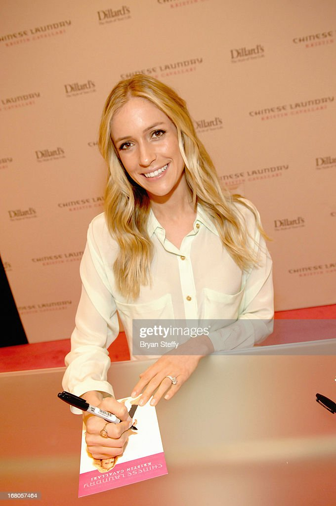 Actress <a gi-track='captionPersonalityLinkClicked' href=/galleries/search?phrase=Kristin+Cavallari&family=editorial&specificpeople=552572 ng-click='$event.stopPropagation()'>Kristin Cavallari</a> signs autographs for fans at Dillard's in support of her new line of Chinese Laundry shoes at the Fashion Show mall on May 4, 2013 in Las Vegas, Nevada.