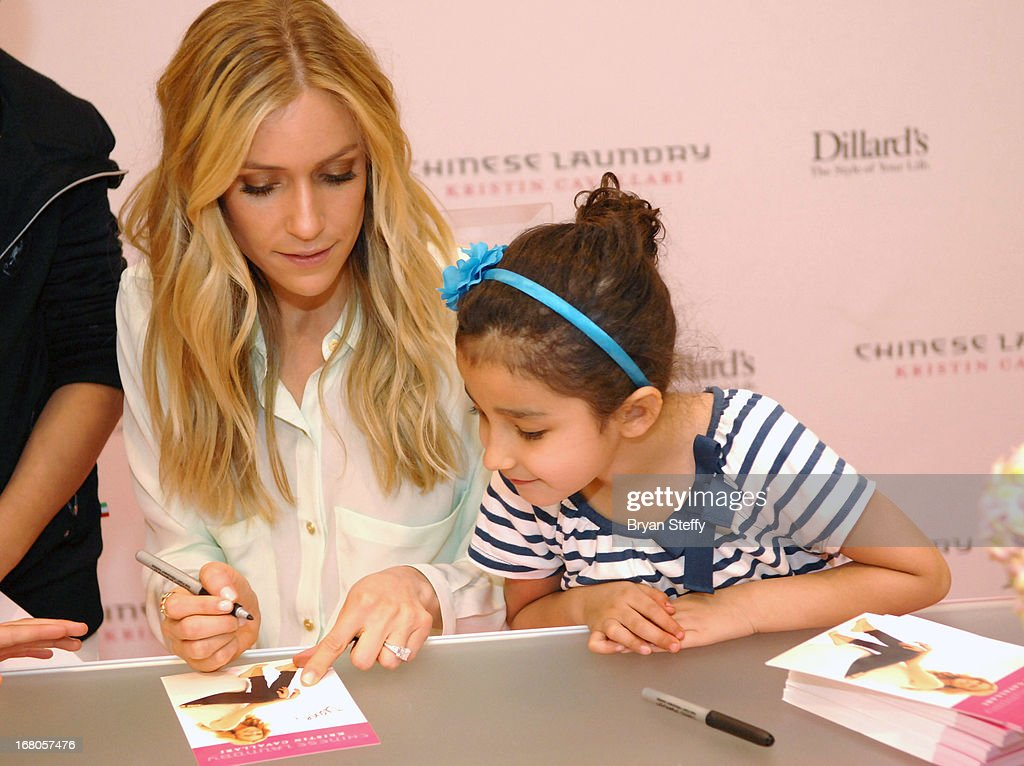 Actress <a gi-track='captionPersonalityLinkClicked' href=/galleries/search?phrase=Kristin+Cavallari&family=editorial&specificpeople=552572 ng-click='$event.stopPropagation()'>Kristin Cavallari</a> (L) signs autographs for fans at Dillard's in support of her new line of Chinese Laundry shoes at the Fashion Show mall on May 4, 2013 in Las Vegas, Nevada.