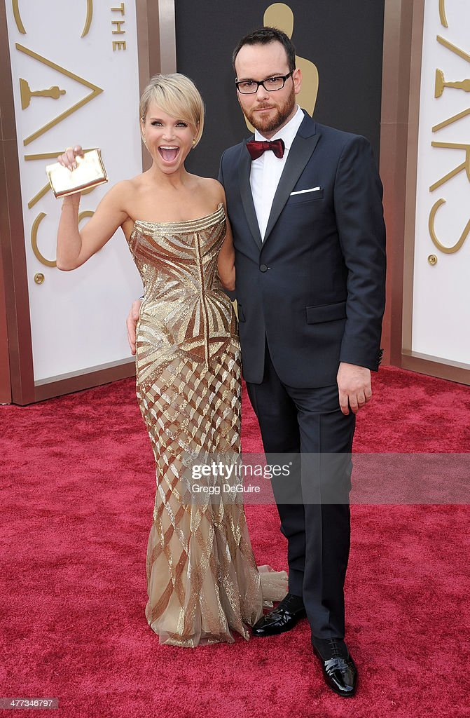 Actress Kristin Chenoweth and Dana Brunetti arrive at the 86th Annual Academy Awards at Hollywood & Highland Center on March 2, 2014 in Hollywood, California.