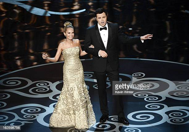 Actress Kristin Chenoweth and host Seth MacFarlane perform onstage during the Oscars held at the Dolby Theatre on February 24 2013 in Hollywood...