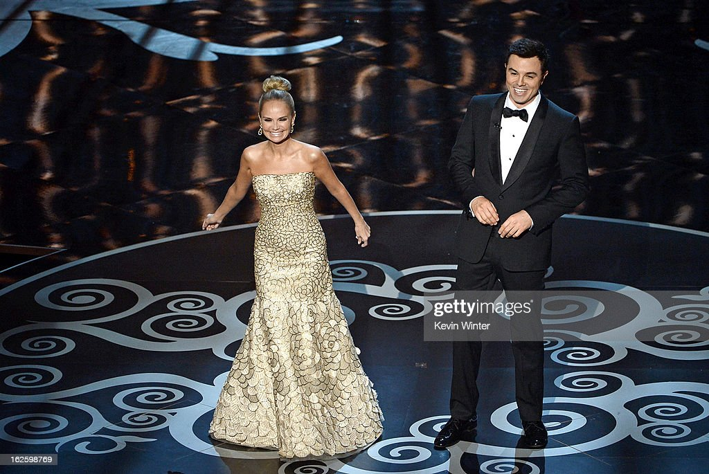 Actress <a gi-track='captionPersonalityLinkClicked' href=/galleries/search?phrase=Kristin+Chenoweth&family=editorial&specificpeople=207096 ng-click='$event.stopPropagation()'>Kristin Chenoweth</a> and host <a gi-track='captionPersonalityLinkClicked' href=/galleries/search?phrase=Seth+MacFarlane&family=editorial&specificpeople=549856 ng-click='$event.stopPropagation()'>Seth MacFarlane</a> perform onstage during the Oscars held at the Dolby Theatre on February 24, 2013 in Hollywood, California.