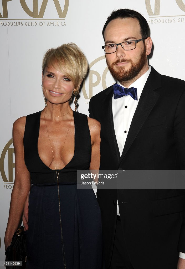 Actress Kristin Chenoweth and producer Dana Brunetti attend the 25th annual Producers Guild Awards at The Beverly Hilton Hotel on January 19, 2014 in Beverly Hills, California.
